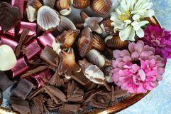 Flowers and chocolate Stock Photos