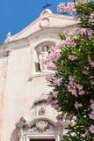 Flowers and Church San Giuseppe in Taormina city Royalty Free Stock Photo