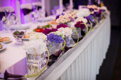 Flowers closeup at wedding reception table Stock Image