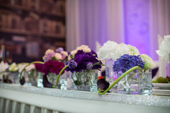 Flowers closeup at wedding reception table in purple Royalty Free Stock Images