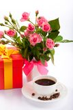 Flowers, coffee and gift box. Stock Photos