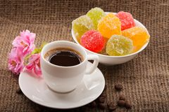 Flowers, coffee and sweets. Stock Image