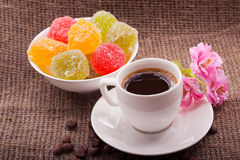 Flowers, coffee and sweets. Royalty Free Stock Photography