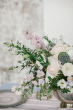 Flowers composition with cotton flower in silver bowl. Stock Photography