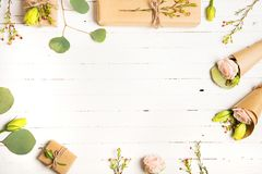 Flowers composition. Flowers and gifts on white background. Flat lay, top view. stock images