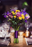 Flowers composition in restaurant, bouquet of roses different varieties Royalty Free Stock Image