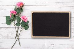 Flowers composition for Valentine`s, Mother`s or Women`s Day. Pink rose on old white wooden background. stock photo