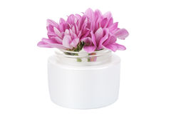 Flowers in cosmetic bottle isolated Stock Image