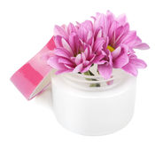 Flowers in cosmetic bottle isolated Royalty Free Stock Images