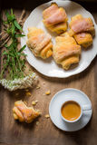 Flowers, croissants, espresso for breakfast Royalty Free Stock Photo