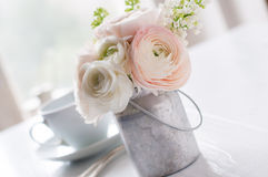 Flowers and cup Royalty Free Stock Image