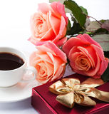 Flowers, cup of coffee and sweets. Stock Photography