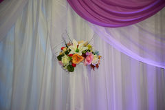 The flowers on the curtains. Flowers on a white curtains hang Stock Image