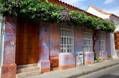 Flowers decorate a purple colonial house in Cartagena royalty free stock images