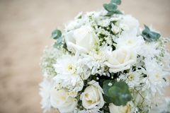 Flowers decorate at a wedding ceremony on the beach. royalty free stock photos