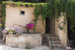 Flowers Decorated barn. With old iron agriculture's  tools Royalty Free Stock Images
