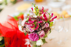 Flowers on decorated table Royalty Free Stock Photography