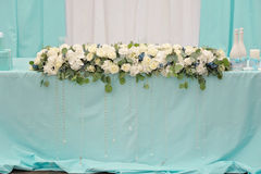 Flowers decoration on wedding table. Rich bunch of roses and leaves Stock Photos