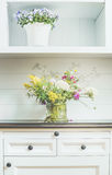 Flowers decoration on white dresser. Light floral Home decoration Royalty Free Stock Photo