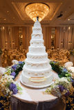 Flowers and decorations around wedding cake with chandelier on c Royalty Free Stock Images