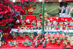 Flowers decorations and traditional gifts at Christmas market Royalty Free Stock Images
