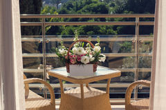 Flowers are delivered. A floral busket on the glass terrace table Stock Images