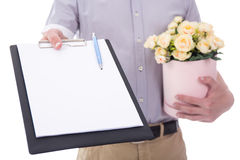 Flowers delivery - flowers and blank clipboard in male hands iso Royalty Free Stock Photo