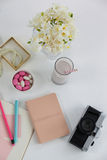 Flowers, diary, camera, glass and pearl necklace Royalty Free Stock Photos