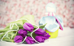Flowers and doll. Retro photo Royalty Free Stock Photo