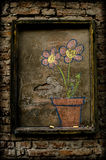 Flowers drawing on a brick wall Royalty Free Stock Images