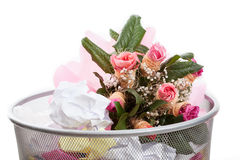 Flowers in dustbin Royalty Free Stock Photography