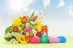 Flowers with easter eggs Stock Photos