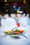 Flowers on elegant dining table Royalty Free Stock Image