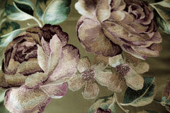 Flowers embroidered on fabric. Satin royalty free stock image