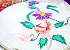 Flowers Embroidery. Sewing accessories. Canvas, hoop and thread mou. Embroidery Flowers. Sewing accessories. Canvas, hoop and thread mouline. Needlework. Hand Stock Image