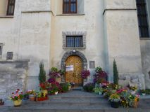 Flowers at the entrance to the church stock image