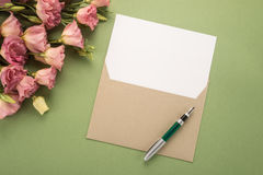 Flowers, envelope and pen Stock Image