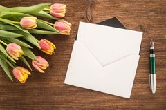 Flowers, envelope and pen Royalty Free Stock Photos