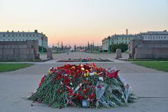 Flowers at the eternal flame at the Champ de Mars at sunset. In Saint-Petersburg Stock Photo