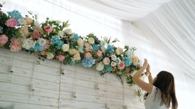 Flowers event wedding decoration. Beautiful florist creating spring colorful bouquet arrangement. Process of preparing floral composition for celebrating party stock video