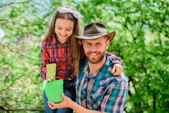 Flowers expert. ecology environment. soils and fertilizers. little girl and happy man dad. earth day. new life. family stock image