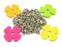 Flowers of felt fraiming a chain Royalty Free Stock Images