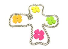 Flowers of felt in a metal cross Royalty Free Stock Image