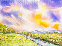 Flowers field and colorful sky watercolor painted. Flowers field with river and colorful sky watercolor on paper Stock Photography