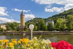 Flowers in a flower pot overlooking river Lahn and the spa town Bad Ems in Germany Stock Image