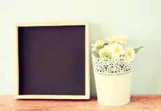 Flowers in flowerpot on wooden shelf. Pic royalty free stock images