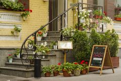 Flowers and flowerpots adorning the stairs in the cafe Stock Photo