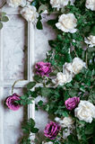 Flowers in a frame on the wall for wedding decoration Stock Photography