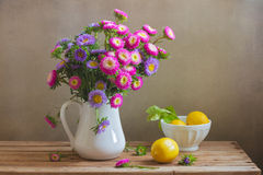 Flowers and fresh lemons for Mother's day celebration Stock Photo