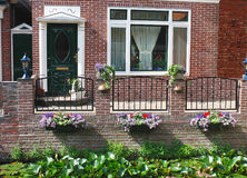 Flowers in front of the Dutch house. stock photo
